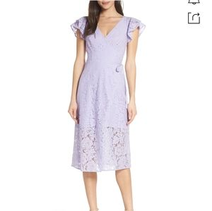 RUFFLE SLEEVE WRAP LACE MIDI DRESS IN LAVENDER